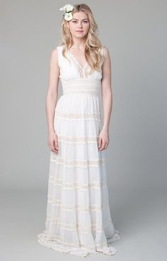 For the bohemian bride, this flowy, tiered dress features chiffon panels that keep it light and airy with delicate cotton lace embroidery. Perfect for a forest or garden ceremony. As a guideline to making your gown, please send us your measurements for bust, waist, hip. SIZE CHART Bust