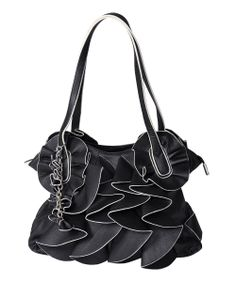 With a riot of ruffles and chic faux leather texture 994945d5b498b