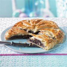 Chocolate and hazelnut pithivier recipe. The pithivier orginates from France, where they know a thing or two about pastry, and chocolate for that matter. Wow your friends and family with your culinary knowledge and this rich chocolate and hazlenut pithivier recipe.