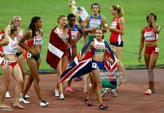 Jessica Ennis-Hill of Great Britain (C) celebrates after winning the Women's Heptathlon 800 metres and the overall Heptathlon gold during day two of the 15th IAAF World Athletics Championships Beijing 2015 at Beijing National Stadium on August 23, 2015 in Beijing, China.