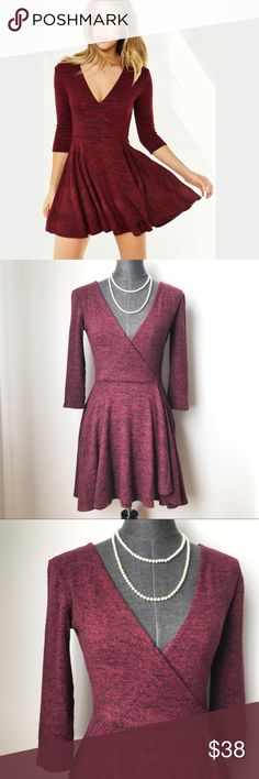 """NWOT Kimchi Blue Ballet Wrap Dress Maroon d e s c r i p t i o n  Incredibly soft, this flowy wrap mini dress (or long top) from Kimchi Blue is the perfect day-to-night outfit. Decent amount of stretch. In new without tags condition. Makes a great spring dress!  c o n t e n t  55% rayon 