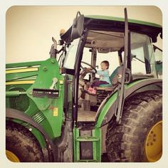 Day 27: Boost. Jessie needed a bit of a boost to get up onto the huge tractor but once up there loved it - unlike her tractor obsessed twin brother who when faced with the real thing held onto mummy's leg and didn't want a go! #totsbots