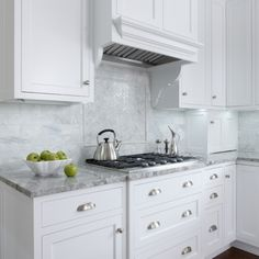 Beautiful kitchen features white shaker cabinets paired with Super White Quartzite countertops and calcutta marble subway tile backsplash. Kitchen Countertop Materials, Granite Kitchen, Kitchen Tiles, Kitchen Countertops, New Kitchen, Kitchen Decor, Kitchen Backplash, Kitchen 2016, Super White Granite