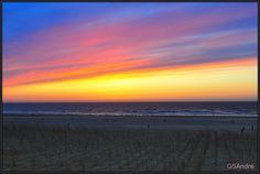 Zonsondergang aan zee!