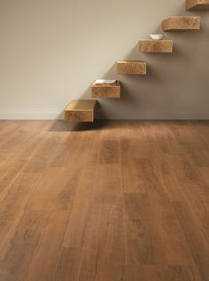 Ashdown Plum by Amtico Flooring at Bell of Northampton. Rich, warm colour, classic look with modern staircase