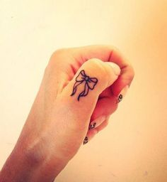 If you've been thinking about getting a tattoo, but are keen to opt for something subtle, small or tiny, then a delicate finger tattoo could be just for you. Finger tattoos are super adorable and beautiful on its own. Finger tattoos are fun to conc Mini Tattoos, Girl Finger Tattoos, Finger Tattoo For Women, Small Finger Tattoos, Small Girl Tattoos, Tattoos For Women, Tattoo Finger, Ring Finger, Wrist Tattoo