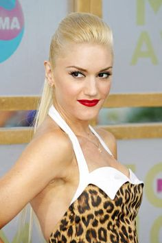 Sporting another dress from her L.A.M.B. label, Stefani pairs a bold leopard print with a poufy ponytail at the 2005 MTV Video Music Awards.