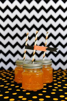 Top Halloween potion concoctions with Halloween themed striped straws.