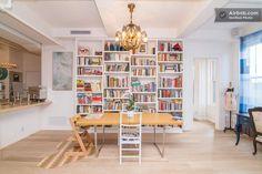 Light filled historical corner loft in New York Ny Loft, New York Loft, Bookshelves, Bookcase, Table Seating, Perfect Place, Corner Desk, Condo, Luxury