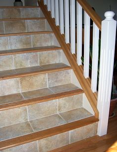 love this for stairs - more durable & safer than just wood (image this with slate)