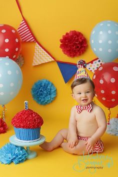 A twist on the classic Circus theme with brighter colors! 1st birthday boy smash cake!