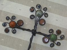 Wire and decorative bead cross by CraftingAFamily4 on Etsy, $28.00