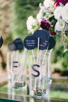 Escort cards, arranged alphabetically, because the last thing guests want to do upon entering an awesome reception is stare at an escort card table or sign arranged by table number and try to find their name. Alphabetically, people. It's just easier.