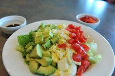 Modified cobb salad with hard-boiled eggs, tomatoes, lettuce, and avocado with balsamic vinegar as a dressing.  Served with a couple of strawberries cut up.