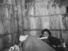 Che Guevara reading Faust in the Sierra Maestra, during the Cuban Revolution.