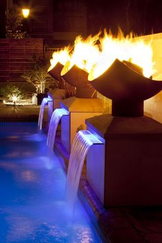 Pool fountain with fire pits on pillars - That's pretty cool!