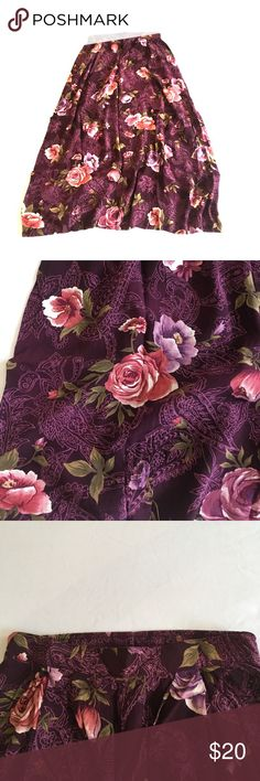 VINTAGE floral purple and pink high waisted Skirt Beautiful, flowing high waisted vintage skirt. Lovely detail and comfortable elastic back waistline. Fits to above my ankle. Says size 12 but fits like a small (2/4) Skirts Midi
