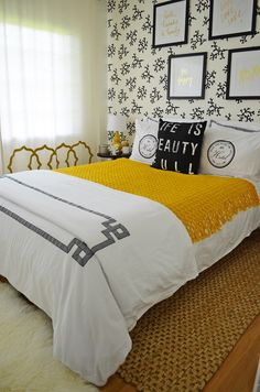 A SUMMERY GUEST BEDROOM: This room used the sunny Florida coast as a color reference and a surprisingly chic color palette of white, black and yellow. Beachy doesn't always have to be blue! This bold yellow throw with black and gold wall art adds just the right pop of sophisticated summer color. (Sponsored Pin)