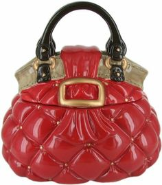 """NM Red Quilted Bag Cookie Jar by David's Cookies. $24.99. Stylish red quilted pattern. Cookie jar made of dolomite. Measures 8.75""""W x 7""""D x 8.5""""T. Hand washing is recommended. Your favorite cookie jar is now available. This red quilted handbag jar measures 8.75""""W x 7""""D x 8.5""""T and is made of dolomite. Hand washing is recommended."""