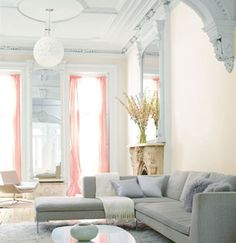 Draperies panels on tall narrow windows.  Contemporary furniture in traditional architecture.