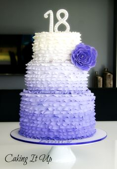 Fondant ombre ruffled cake with sugar flower in purple hues www.facebook.com/cakingitup