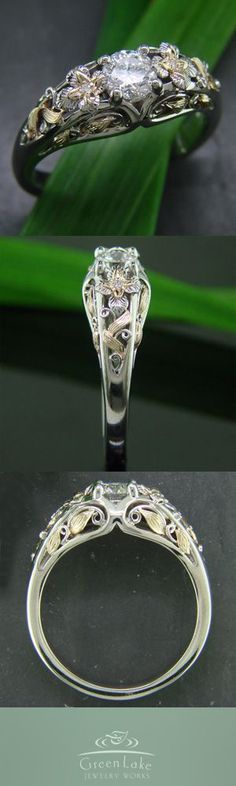 Custom 14k gold two toned, and filigree-filled diamond engagement ring with engraved leaves and flowers.