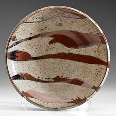 Warren MacKenzie (1924; USA) Large Charger  ca 1987 Glazed stoneware; ht. 4, dia. 19.75 in.  Inventory sticker on base WM22/1955; Artist stamp at foot. MacKenzie is the first American apprentice to the father of studio pottery, Bernard Leach.