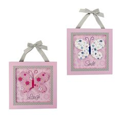 The Just Born Antique Chic 2-Piece 3D Wall Art set will add a pop of precious style to your little lady's nursery. Each wooden square features a 3D butterfly with a fun floral print, while polka-dot accents add a cute touch. 'Laugh' text is displayed on 1 piece, while the other says 'smile.' <br><br> The Just Born Antique Chic 2-Piece 3D Wall Art features:<br><ul><li>Includes 2 wooden wall hangings</li><li>Coordinates with the Antique Chic collection from Just Born</li><li>Decorated in pink…