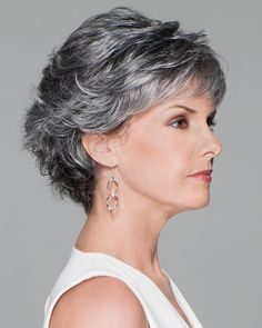 This touseled look boasts lots of texture and style. The wispy bangs give the wig an alluring feel, while the top and back longer strands are styled in a playful fashion. Conviction by Eva Gabor Wigs…More Short Wavy Pixie, Short Grey Hair, Short Hair With Layers, Short Blonde, Short Hair Cuts, Pixie Cut, Short Layered Haircuts, Layered Hairstyles, Braided Hairstyles