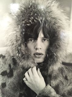 Mick Jagger posing in a fur parka, a sneak peek into Breaking Stones A Band on the Brink of Superstardom. Photographs by Terry O'Neill. (Iconic Images/Terry O'Neill) Terry O Neill, Maria Callas, Brigitte Bardot, Jerry Schatzberg, The Rolling Stones, Georgia May Jagger, Bruce Springsteen, Melanie Hamrick, Rock And Roll