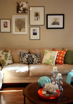 Planning my picture wall for the living room, and I like this mix of frames with all her colors in her furnishings. The framed coral reef thing is lovely.