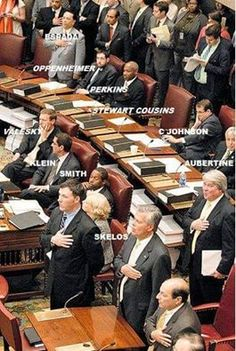 The ones sitting are enemies of the people. VOTE them out!!