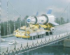 A scene from British science fiction puppet television series Thunderbirds showing a rocket being transported across a suspension bridge