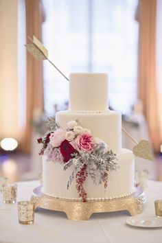 The 25 Prettiest Floral Wedding Cakes You've Ever Seen! The glitter arrow is just an extra treat.
