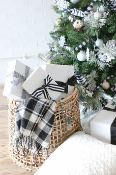 A black and white Christmas tree full of buffalo check pattern. Love this simple and elegant look for a neutral Christmas Tree. Wrap all of your gifts in the same wrapping color scheme with pretty ribbons and then display them in a basket.