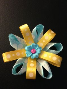 blue and yellow hair bow with blue flower by MelBelleBoutique, $5.00