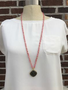 Coral pink gemstone necklace with labradorite pendant by BlushingGemDesigns on Etsy https://www.etsy.com/listing/475854283/coral-pink-gemstone-necklace-with
