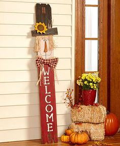Greet guests with this Scarecrow Leaning Sign in your entryway or out on a covered porch. The scarecrow has a metal sunflower on a spring trimming his hat, hair