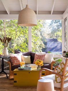 Indoor-Outdoor Connection - Create an ultracomfortable space by adding the same luxuries you enjoy in your living room. Furniture with plush cushions provides a great place to relax. A stylish indoor-outdoor light fixture suspended from the ceiling makes the space usable after dark.