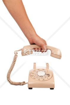 person answering phone. - Close-up shot of human hand picking up receiver of a old fashioned landline phone.