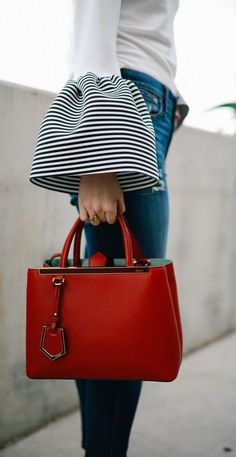 what to wear with a red bag : white long sleeves top and skinny jeans