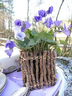 This is a fun way to share a gift from the garden - -I love the twig container.