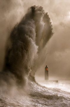 #Lighthouse in a storm! http://travelingcolors.net/tagged/wales