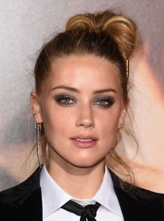 Amber Heard pulled off this messy top bun at the premiere of 'The Danish Girl.'