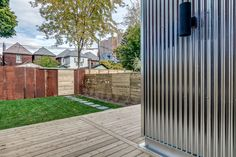 View captures new corrugated steel on additional as well as the upcycled corrugates steel on rear fence Fence, Steel, Outdoor Decor, Modern, House, Life, Beautiful, Home Decor, Trendy Tree