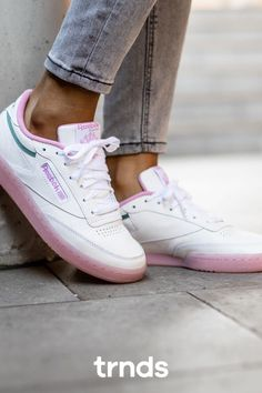 Reebok Club C 85 White/Green Slate-Jasmine Pink for Women. Confidence cuts through the noise. These women's Club C Ree:Dux shoes take design cues from the clean, minimalist original and reinvent it for today. A logo from the early 2000s adds texture and attitude. A repeating logo pattern set off by contrast zig-zag stitching gives the shoes extra flair. #afflink #reebok #clubc85 #reebokclubc #sneakers #womenshoes #pink Club C 85, Baskets, White Reebok, Reebok Club C, Air Max 95, Fashion Games, Jasmine, Air Jordans, Adidas Sneakers