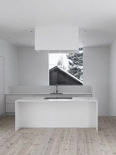 Minimalist White Kitchen with Framing Window