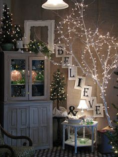 Love this white hutch with the lighted tree on the top.