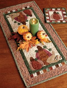 """Pumpkin Patch"" table runner and hot pad by Kelly Mueller; find both patterns in the book Table Toppers."