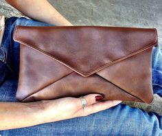 Brown Leather Clutch with hot pink satin inside. $40.00, via Etsy.